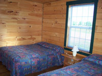 Log Cabin Rental Photos - Living Room Looking Toward One Bedroom and the Stairs - Maine Whitewater